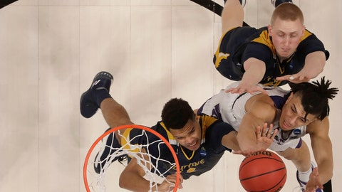 <p>               Kansas State guard Mike McGuirl, bottom right, shoots against UC Irvine guard Evan Leonard, left, and UC Irvine forward Collin Welp during the second half of a first round men's college basketball game in the NCAA Tournament Friday, March 22, 2019, in San Jose, Calif. (AP Photo/Ben Margot)             </p>
