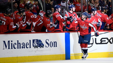 <p>               Washington Capitals left wing Carl Hagelin (62), of Sweden, celebrates his goal with the bench during the second period of an NHL hockey game against the Winnipeg Jets, Sunday, March 10, 2019, in Washington. (AP Photo/Nick Wass)             </p>