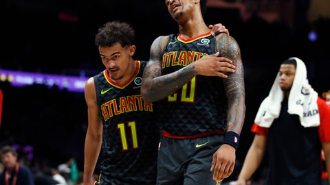 <p>               FILE - In this Jan. 19, 2019, file photo, Atlanta Hawks guard Trae Young (11) and forward John Collins (20) leave the court after the team's 113-105 loss to the Boston Celtics in an NBA basketball game, in Atlanta. The instant camaraderie these two talented youngsters have make the Hawks one of the most intriguing storylines in the NBA losers bracket. (AP Photo/Todd Kirkland, File)             </p>