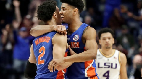 <p>               Florida guard Andrew Nembhard (2) is hugged by Jalen Hudson after Nembhard hit the winning 3-point basket against LSU in the second half of an NCAA college basketball game at the Southeastern Conference tournament Friday, March 15, 2019, in Nashville, Tenn. Florida won 76-73. At right is LSU guard Skylar Mays (4). (AP Photo/Mark Humphrey)             </p>