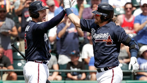<p>               FILE - In this March 15, 2019, file photo, Atlanta Braves' Josh Donaldson, right, gets a high-five from teammate Freddie Freeman after hitting a two-run home run in the third inning against the Miami Marlins in a spring baseball exhibition game in Kissimmee, Fla. Freeman believes the Phillies, Nationals and Mets had busy offseasons because they wanted to catch up to the 2018 NL East champion Braves. (AP Photo/John Raoux, File)             </p>