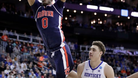 <p>               Auburn's Horace Spencer (0) dunks over Kentucky's Reid Travis (22) during the first half of the Midwest Regional final game in the NCAA men's college basketball tournament Sunday, March 31, 2019, in Kansas City, Mo. (AP Photo/Charlie Riedel)             </p>