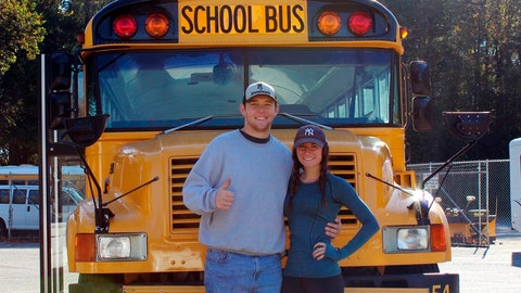 <p>               In this photo taken with a timer Oct. 30, 2018, Jack Labosky, left, and Madi Hiatt pose after purchasing a school bus in Lynchburg, Va. Labosky is a minor league pitcher in the Tampa Bay Rays organization, and he and Hiatt, his girlfriend, plan to live out of the bus during his first full professional season. The couple hopes to save money on rent to help offset Labosky's meager minor league salary. (Madi Hiatt via AP)             </p>