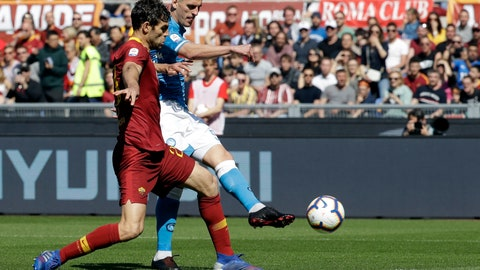 <p>               Napoli's Arkadiusz Milik, right, scores past Roma's Federico Fazio his side's opening goal during a Serie A soccer match between Roma and Napoli, at the Rome Olympic Stadium, Sunday, March 31, 2019. (AP Photo/Andrew Medichini)             </p>