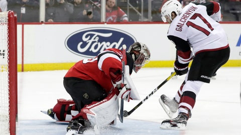 <p>               New Jersey Devils goaltender MacKenzie Blackwood, left, blocks a shootout shot by Arizona Coyotes center Alex Galchenyuk (17) during an NHL hockey game, Saturday, March 23, 2019, in Newark, N.J. The Devils on 2-1 in a shootout. (AP Photo/Julio Cortez)             </p>