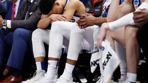 <p>               Kansas guard Devon Dotson (11) sits on the bench in the closing minutes of the team's loss to Auburn in a second-round game in the NCAA men's college basketball tournament Saturday, March 23, 2019, in Salt Lake City. (AP Photo/Jeff Swinger)             </p>