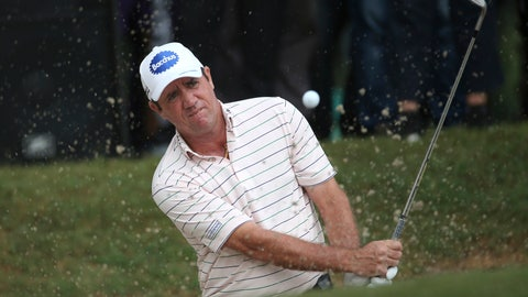 <p>               Scott Hend of Australia play his shot from a bunker on the 18th hole in a playoff on the way to winning the Malaysia Golf Championship in Kuala Lumpur, Malaysia, Sunday, March 24, 2019. (AP Photo/Vincent Phoon)             </p>