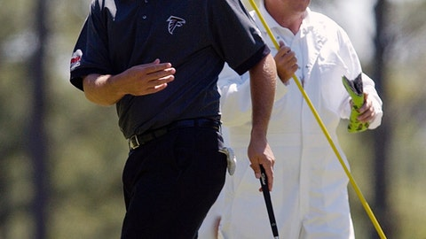 <p>               FILE - In this April 5, 2004, file photo, Ben Curtis discusses his placement on the third green with his caddy and former Kent State University coach, Herb Page, during practice for the 2004 Masters golf tournament at the Augusta National Golf Club in Augusta, Ga. Longtime Kent State golf coach Herb Page will retire at the end of this season and end his storied run at the school. Page has coached the Golden Flashes since 1977, building the men's golf program into one of the nation's most consistent and decorated. Under Page, Kent State has won 22 Mid-American Conference titles, appeared in 17 NCAA championships and he's had 28 All-Americans, including Ben Curtis, the 2003 British Open champion. (AP Photos/David J. Phillip, File)             </p>