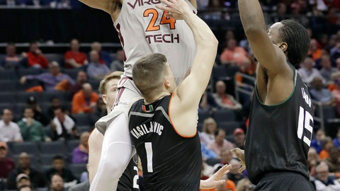 <p>               Virginia Tech's Kerry Blackshear Jr. (24) shoots against Miami's Dejan Vasiljevic (1) and Ebuka Izundu (15) during the first half of an NCAA college basketball game in the Atlantic Coast Conference tournament in Charlotte, N.C., Wednesday, March 13, 2019. (AP Photo/Chuck Burton)             </p>
