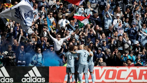<p>               Sporting Kansas City players celebrate a goal during the first half of an MLS soccer match against the Philadelphia Union in Kansas City, Kan., Sunday, March 10, 2019. The goal was scored by Sporting Kansas City midfielder Ilie Sanchez (unseen). (AP Photo/Orlin Wagner)             </p>