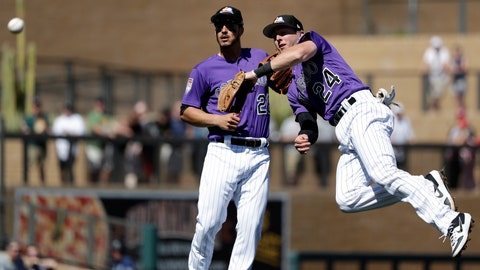 <p>               Colorado Rockies second baseman Ryan McMahon (24) throws to first as third baseman Nolan Arenado looks on after McMahon fielded a ground ball from Cincinnati Reds' Jesse Winker in the third inning of a spring training baseball game Monday, March 18, 2019, in Scottsdale, Ariz. Winker was out on the play. (AP Photo/Elaine Thompson)             </p>