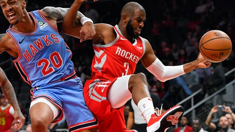 <p>               Atlanta Hawks forward John Collins (20) and Houston Rockets guard Chris Paul vie for a rebound during the first quarter of an NBA basketball game Tuesday, March 19, in Atlanta. (AP Photo/John Amis)             </p>