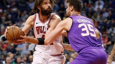 <p>               Chicago Bulls center Robin Lopez looks to shoot over Phoenix Suns forward Dragan Bender (35) during the second half of an NBA basketball game, Monday, March 18, 2019, in Phoenix. (AP Photo/Matt York)             </p>