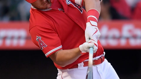 <p>               Los Angeles Angels' Mike Trout hits an RBI double during the third inning of a preseason baseball game against the Los Angeles Dodgers on Sunday, March 24, 2019, in Anaheim, Calif. (AP Photo/Mark J. Terrill)             </p>