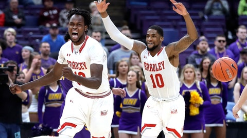 <p>               Bradley's Koch Bar and Elijah Childs (10) celebrate as the final horn sounds in an NCAA college basketball game against Northern Iowa during the championship of the Missouri Valley Conference tournament, Sunday, March 10, 2019, in St. Louis. Bradley won 57-54. (AP Photo/Jeff Roberson)             </p>