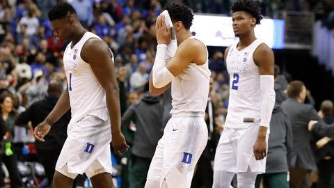 <p>               Duke guard Tre Jones, center, covers his face as he walks off the court with teammates Zion Williamson (1) and Cam Reddish (2) after losing to Michigan State in the NCAA men's East Regional final college basketball game in Washington, Sunday, March 31, 2019. (AP Photo/Alex Brandon)             </p>
