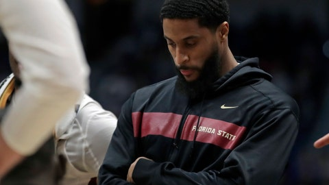 <p>               Florida State's Phil Cofer watches during a team huddle in the second half of a second round men's college basketball game against Murray State in the NCAA Tournament, Saturday, March 23, 2019, in Hartford, Conn. Florida State won 90-62. (AP Photo/Elise Amendola)             </p>