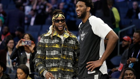 <p>               Team Giannis' Joel Embiid, of the Philadelphia 76ers, speaks with Rapper 2 Chainz ahead of the first half of an NBA All-Star basketball game, Sunday, Feb. 17, 2019, in Charlotte, N.C. (AP Photo/Chuck Burton)             </p>