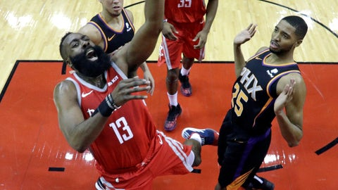 <p>               Houston Rockets' James Harden (13) shoots as Phoenix Suns' Mikal Bridges (25) and Devin Booker, left, defend during the first half of an NBA basketball game Friday, March 15, 2019, in Houston. (AP Photo/David J. Phillip)             </p>