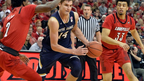 <p>               Notre Dame forward Nate Laszewski (14) drives between the defense of Louisville guard Darius Perry (2), and forward Jordan Nwora (33) during the first half of an NCAA college basketball game in Louisville, Ky., Sunday, March 3, 2019. (AP Photo/Timothy D. Easley)             </p>
