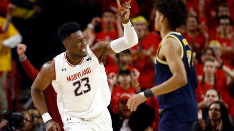 <p>               Maryland forward Bruno Fernando (23), of Angola, gestures in front of Michigan guard Jordan Poole after making a basket in the first half of an NCAA college basketball game, Sunday, March 3, 2019, in College Park, Md. (AP Photo/Patrick Semansky)             </p>