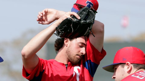 <p>               FILE - In this Feb. 19, 2019, file photo, Philadelphia Phillies starting pitcher Aaron Nola wipes his face at the Phillies spring training baseball facility, in Clearwater, Fla. It may look like a few weeks of relaxed fun in the sun, but make no mistake: Spring training can be a grind. Pitchers need to build their arms up slowly, and position players face their own challenges. At this time of year, Florida and Arizona are obviously better for baseball than many other American climates, but the warm, sunny weather does have a few drawbacks. (AP Photo/Lynne Sladky, File)             </p>