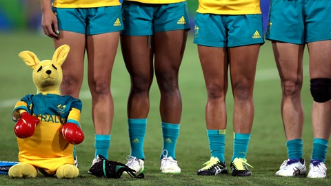 <p>               FILE- In this Aug. 8, 2016, file photo, Australia's players are accompanied by a boxing kangaroo mascot as they line up for the singing of the national anthem during the women's rugby sevens gold medal match at the Summer Olympics in Rio de Janeiro, Brazil. Led by girls and young women, the ruck-and-maul and rougher-than-rough sport of rugby union is looking to regain its relevance in Australia. (AP Photo/Themba Hadebe, File)             </p>