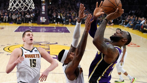 <p>               Los Angeles Lakers forward LeBron James, right, shoots and scores as Denver Nuggets forward Torrey Craig, center, defends and center Nikola Jokic watches during the first half of an NBA basketball game Wednesday, March 6, 2019, in Los Angeles. With the basket, James moved past Michael Jordan for fourth place on the NBA career scoring list. (AP Photo/Mark J. Terrill)             </p>
