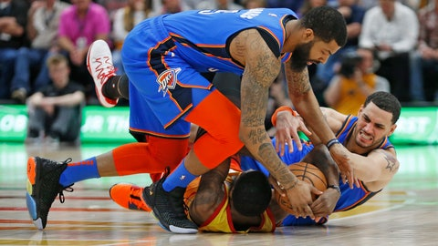 <p>               Utah Jazz forward Royce O'Neale, bottom, battles for the ball against Oklahoma City Thunder's Abdel Nader, right, and Markieff Morris, top, in the first half during an NBA basketball game Monday, March 11, 2019, in Kearns, Utah. (AP Photo/Rick Bowmer)             </p>