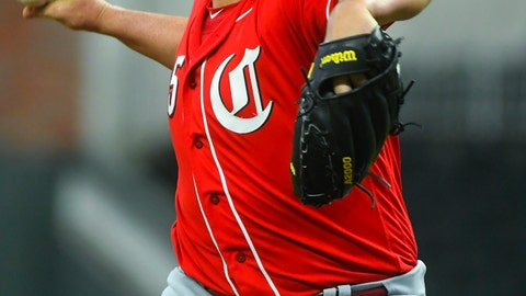 <p>               Cincinnati Reds' Tanner Roark pitches during the first inning of an exhibition baseball game against the Atlanta Braves, Monday, March 25, 2019, in Atlanta. (AP Photo/John Amis)             </p>