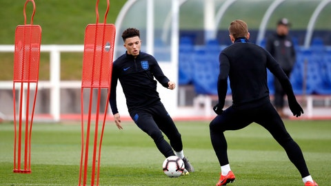 <p>               England's Jadon Sancho, left, during a training session for England soccer team at St George's Park in Burton, England, Tuesday March 19, 2019. England play the Czech Republic in a Euro qualifier match on upcoming Friday March 22.(Martin Rickett/PA via AP)             </p>