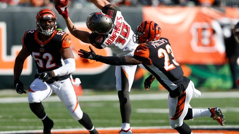 "<p>               FILE - In this Oct. 28, 2018,. file photo, Tampa Bay Buccaneers wide receiver Adam Humphries (10) makes a catch between Cincinnati Bengals cornerback Darius Phillips (23) and linebacker Preston Brown (52) during the second half of an NFL football game, in Cincinnati. For Adam Humphries, Tennessee has been a potential destination for months based on his relationship with Titans general manager Jon Robinson because of their Tampa Bay connection. Not even a late push by the New England Patriots could sway him to walk away from his deal with the Titans. Even considering how much success wide receivers like Humphries have enjoyed with the defending Super Bowl champs.""Obviously, I'm a man of my word, and I'm going to keep my word there,"" Humphries said Thursday, March 14, 2019, after signing with Tennessee. (AP Photo/Frank Victores, File)             </p>"