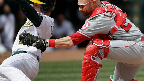 <p>               Oakland Athletics' Matt Chapman, left, is tagged out by Los Angeles Angels catcher Jonathan Lucroy in the third inning of a baseball game Thursday, March 28, 2019, in Oakland, Calif. Chapman was attempting to score on a single by Athletics' Khris Davis. (AP Photo/Ben Margot)             </p>