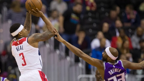 <p>               Washington Wizards guard Bradley Beal (3) shoots over Sacramento Kings guard Corey Brewer (33) during the first half of an NBA basketball game Monday, March 11, 2019, in Washington. (AP Photo/Alex Brandon)             </p>
