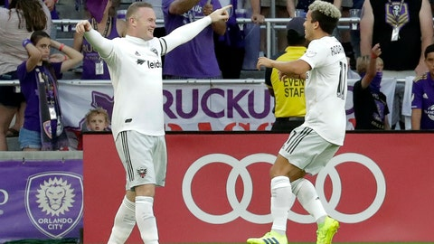 <p>               D.C. United's Wayne Rooney, left, celebrates his goal against Orlando City with teammate Lucas Rodriguez during the first half of an MLS soccer match Sunday, March 31, 2019, in Orlando, Fla. (AP Photo/John Raoux)             </p>