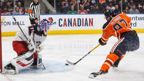 <p>               Columbus Blue Jackets goalie Joonas Korpisalo (70) makes a save on Edmonton Oilers' Connor McDavid (97) during the second period of an NHL hockey game Thursday, March 21, 2019, in Edmonton, Alberta. (Jason Franson/The Canadian Press via AP)             </p>