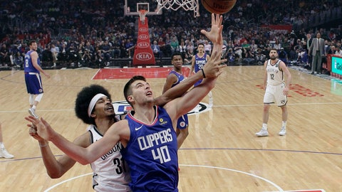 <p>               Los Angeles Clippers' Ivica Zubac (40) grabs a rebound next to Brooklyn Nets' Jarrett Allen, left, during the first half of an NBA basketball game Sunday, March 17, 2019, in Los Angeles. (AP Photo/Marcio Jose Sanchez)             </p>