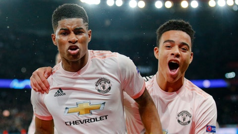 <p>               ManU's Marcus Rashford, left, celebrates after scoring his side's third goal during the Champions League round of 16, second leg soccer match between Paris Saint Germain and Manchester United at the Parc des Princes stadium in Paris, France, Wednesday, March. 6, 2019. (AP Photo/Francois Mori)             </p>