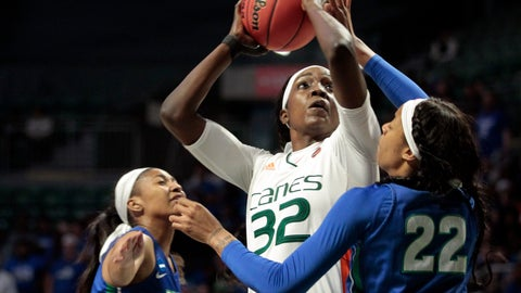 <p>               Miami forward Beatrice Mompremier (32) aims for a basket as Florida Gulf Coast guard Destiny Washington-Mabon (22) and guard Davion Wingate (0) defend, during a first round women's college basketball game in the NCAA Tournament in Friday, March 22, 2019, in Coral Gables, Fla. (AP Photo/Luis M. Alvarez)             </p>