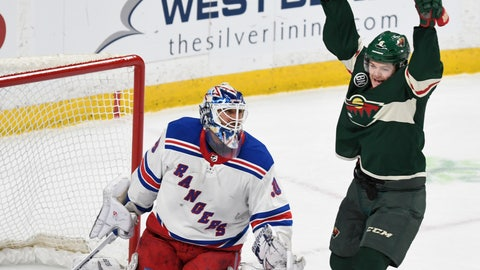 <p>               Minnesota Wild's Ryan Donato, right, celebrates his second goal in front of New York Rangers goalie Henrik Lundqvist, of Sweden, in the first period of an NHL hockey game Saturday, March 16, 2019, in St. Paul, Minn. (AP Photo/Tom Olmscheid)             </p>