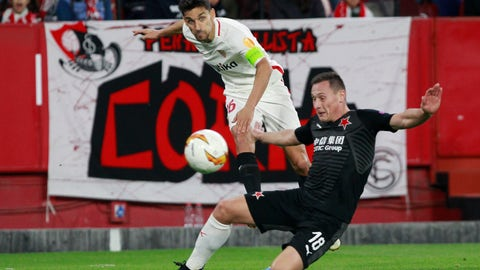 <p>               Sevilla's Jesus Navas, left, fights for the ball with Slavia's Jan Boril, right, during the Europa League round of 16 second leg soccer match between Sevilla and Slavia Praha at the Sanchez Pizjuan stadium, in Seville, Spain, Thursday, March 7, 2019. (AP Photo/Miguel Morenatti)             </p>