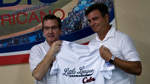 <p>               Stephen D. Keener, Little League International president, left, holds still for photos as he gifts a jersey to Antonio Castro, son of Cuba's late leader Fidel Castro who represents Cuban baseball, during a ceremony in Havana, Cuba, Wednesday, March 6, 2019. Cuban baseball and Little League International are launching a relationship that will allow young Cuban players to participate in international Little League tournaments, following a MLB deal with the Cuban Baseball Federation allowing Cuban players to legally play professionally in the U.S. for the first time. (AP Photo/Ramon Espinosa)             </p>