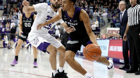 <p>               TCU guard Alex Robinson (25) defends as Kansas State guard Kamau Stokes (3) works to the basket for a shot in the first half of an NCAA college basketball game in Fort Worth, Texas, Monday, March 4, 2019. (AP Photo/Tony Gutierrez)             </p>