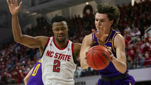 <p>               North Carolina State's Torin Dorn (2) tries to take the ball form Lipscomb's Eli Pepper during the first half of an NCAA college basketball game in the quarterfinals of the NIT on Wednesday, March 27, 2019, in Raleigh, N.C. (Travis Long/The News & Observer via AP)             </p>