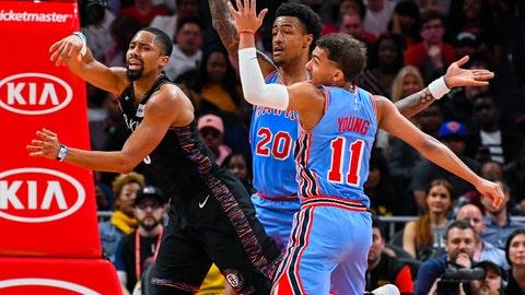 <p>               Brooklyn Nets guard Spencer Dinwiddie passes as Atlanta Hawks forward John Collins (20) and guard Trae Young (11) defend during the second half of an NBA basketball game, Saturday March 9, 2019, in Atlanta. Brooklyn won 114-112. (AP Photo/John Amis)             </p>