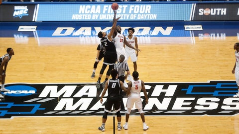 <p>               FILE - In this March 13, 2018, file photo, Radford's Randy Phillips (32) and LIU Brooklyn's Julius van Sauers (2) tip off during the first half of a First Four game of the NCAA men's college basketball tournament, in Dayton, Ohio. Dayton stages the four play-in games over two nights, assuring the city and the private University of Dayton a nice slice of the NCAA Tournament pie every March. The city will host the event at least through 2022 after beating out Detroit and Evansville, Indiana, for the current four-year contract. (AP Photo/John Minchillo, File)             </p>