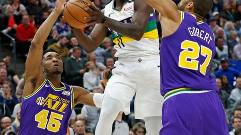 <p>               Utah Jazz's Donovan Mitchell (45) and Rudy Gobert (27) defend against New Orleans Pelicans guard Jrue Holiday (11) in the first half during an NBA basketball game Monday, March 4, 2019, in Salt Lake City. (AP Photo/Rick Bowmer)             </p>