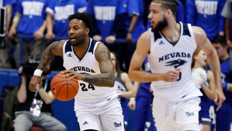 <p>               Nevada forward Jordan Caroline, back, picks up a loose ball and trails forward Caleb Martin down the court against Air Force during the first half of an NCAA college basketball game Tuesday, March 5, 2019, at Air force Academy, Colo.(AP Photo/David Zalubowski)             </p>
