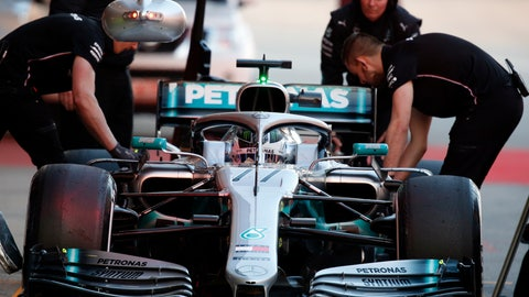 <p>               FILE - In this file photo dated Thursday, Feb. 21, 2019, Mechanics prepare Mercedes driver Valtteri Bottas of Finland car during a Formula One pre-season testing session at the Barcelona Catalunya racetrack in Montmelo, outside Barcelona, Spain. Previewing the upcoming 2019 season, for Bottas, even though he didn't win a single race in 2018, the Finnish driver still believes he can be a genuine challenger for the title this season, even though that will mean challenging his Mercedes teammate Lewis Hamilton. (AP Photo/Joan Monfort, FILE)             </p>