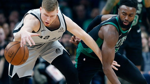 <p>               San Antonio Spurs' Davis Bertans (42) and Boston Celtics' Jaylen Brown, right, battle for the ball during the first half of an NBA basketball game in Boston, Sunday, March 24, 2019. (AP Photo/Michael Dwyer)             </p>